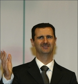Assad_w_hand_outstretched