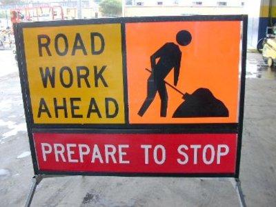 Road_work_ahead_prepare_to_stop