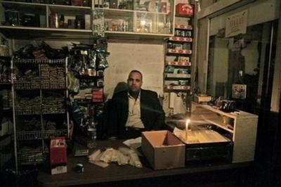 Pal_sells_candles_gaza_city_012008