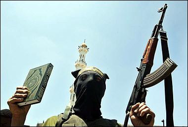 islamic_jihad_w_koran_and_rifle.jpg
